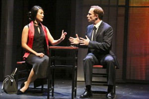 Xi Yan, Vice Minister of Culture, played by Kara Wang, explains a situation to American businessman Daniel Cavanaugh, played by Matthew Jaeger in East West Players production of David Henry Hwang's Chinglish.